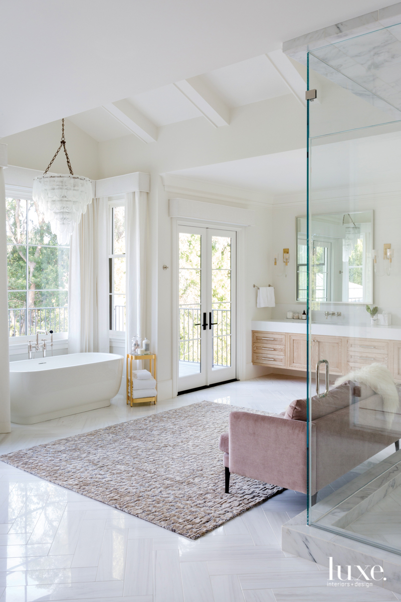 In the master bathroom, an...