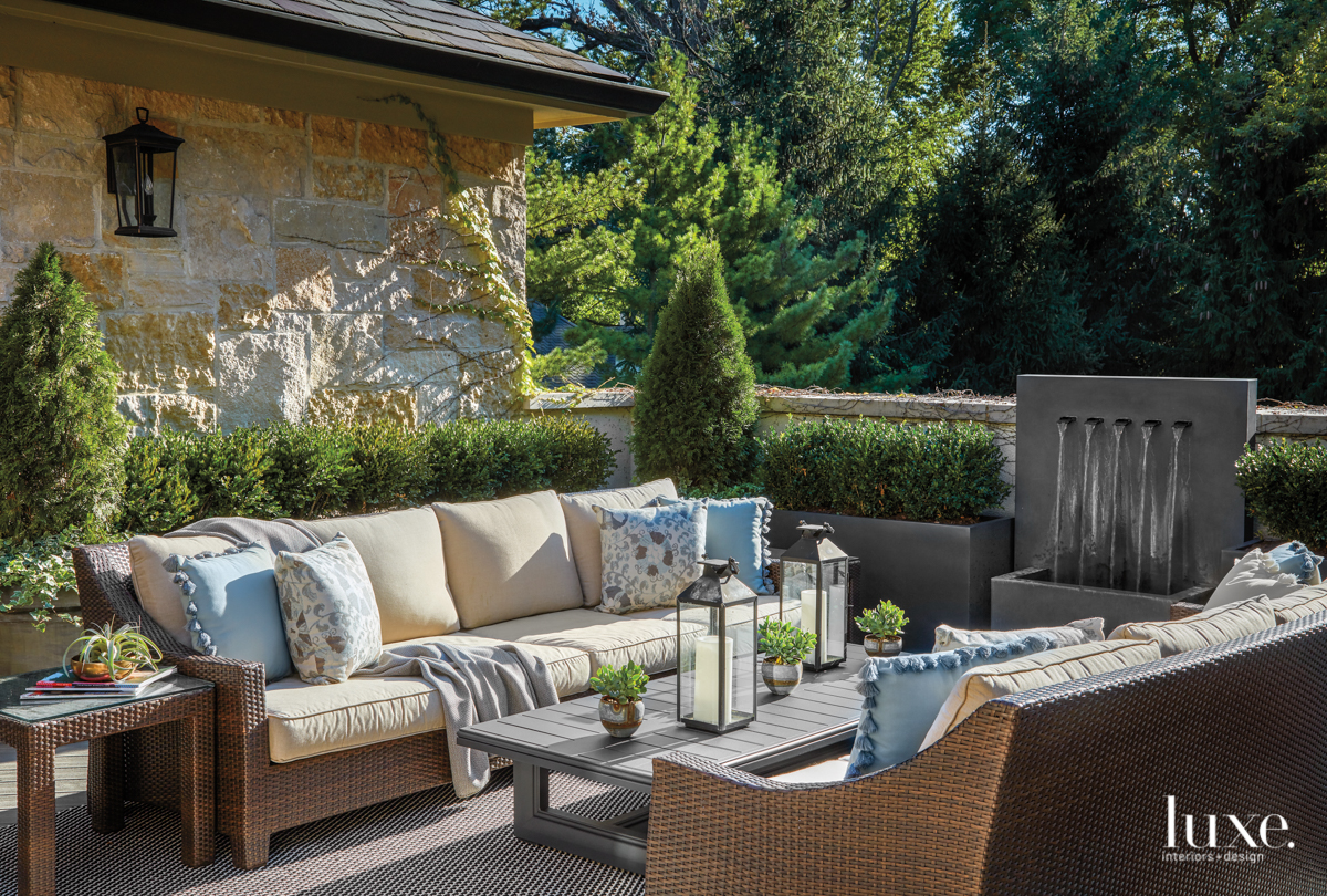 outdoor terrace with sofa and...