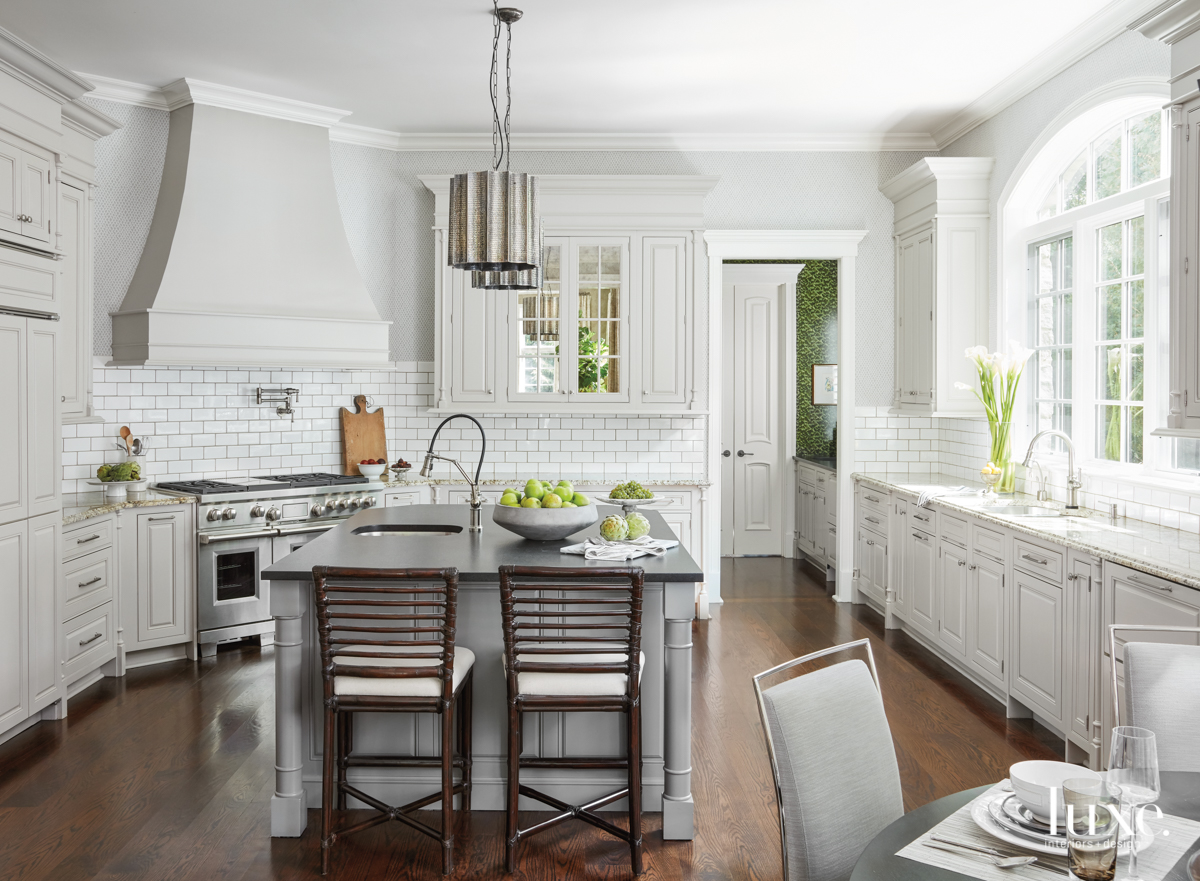 traditional white kitchen with gray...