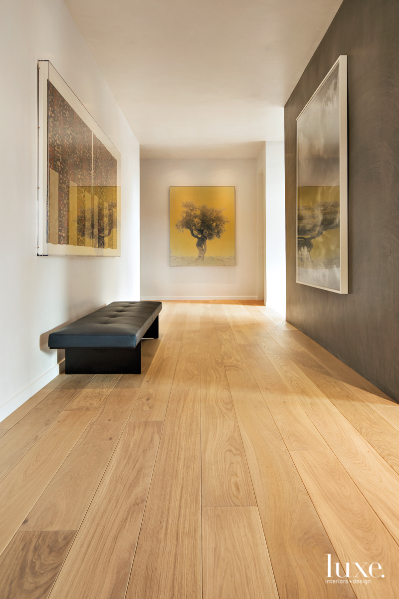 modern neutral hallway with artwork/photographs