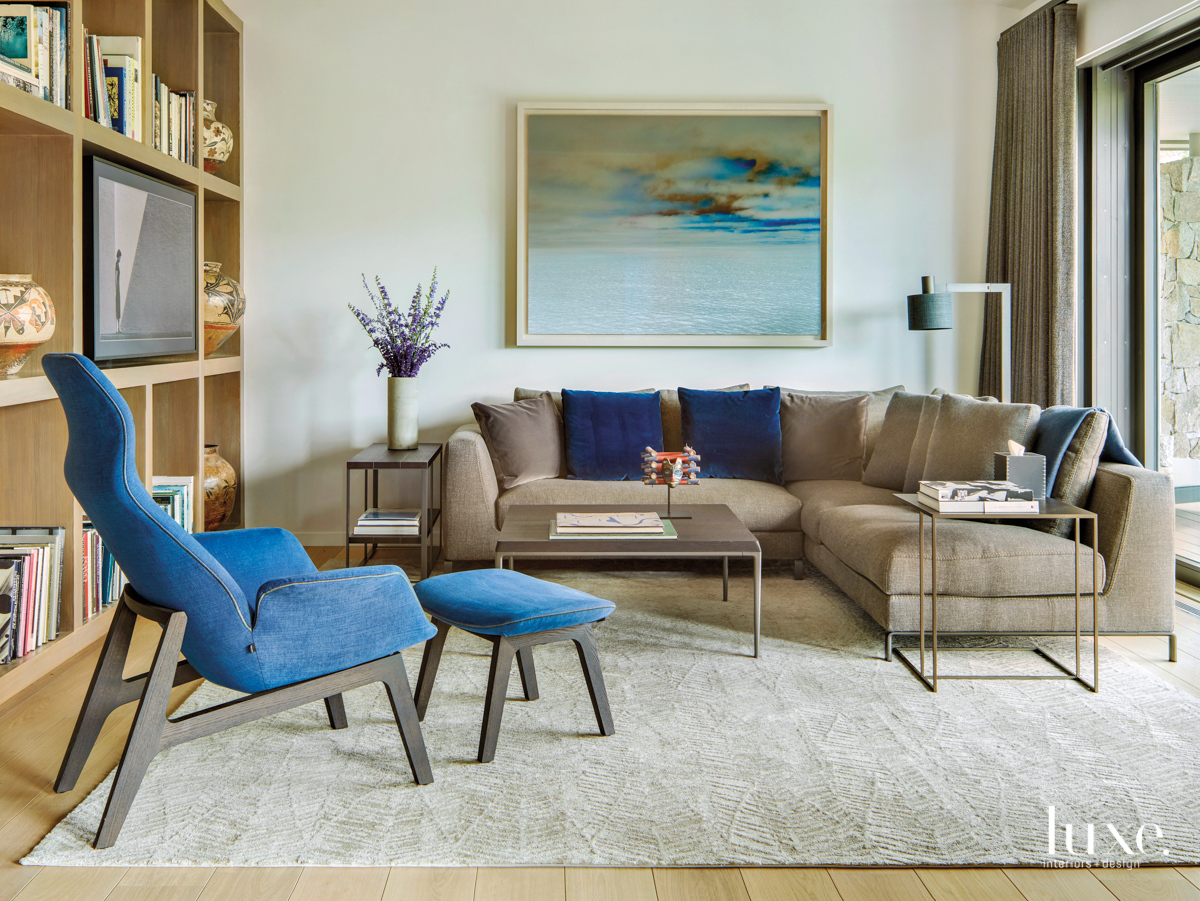 modern neutral den with blue accents