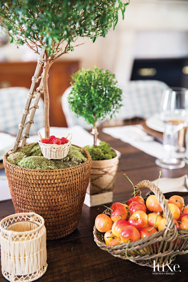 "Whimsical elements and bright colors that embrace a party's theme ensure a soiree never becomes too serious. For Moss's annual ""Caftan Caucus,"" she filled miniature doll baskets with fruit."
