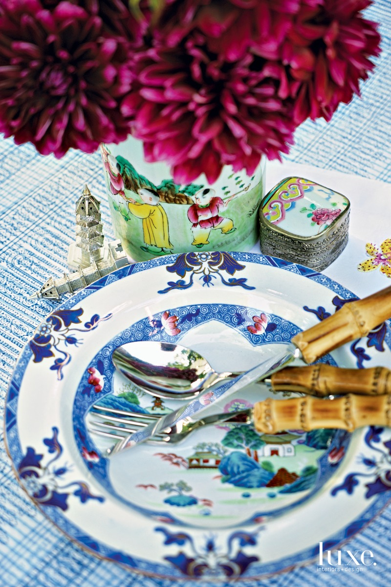 """A table setting is like a collage,"" Moss says. ""You start with an idea, one item, then build around it, layering in everything needed to complete the story."" Here, a delightful mix of china and tableware creates a playful lunch setting."