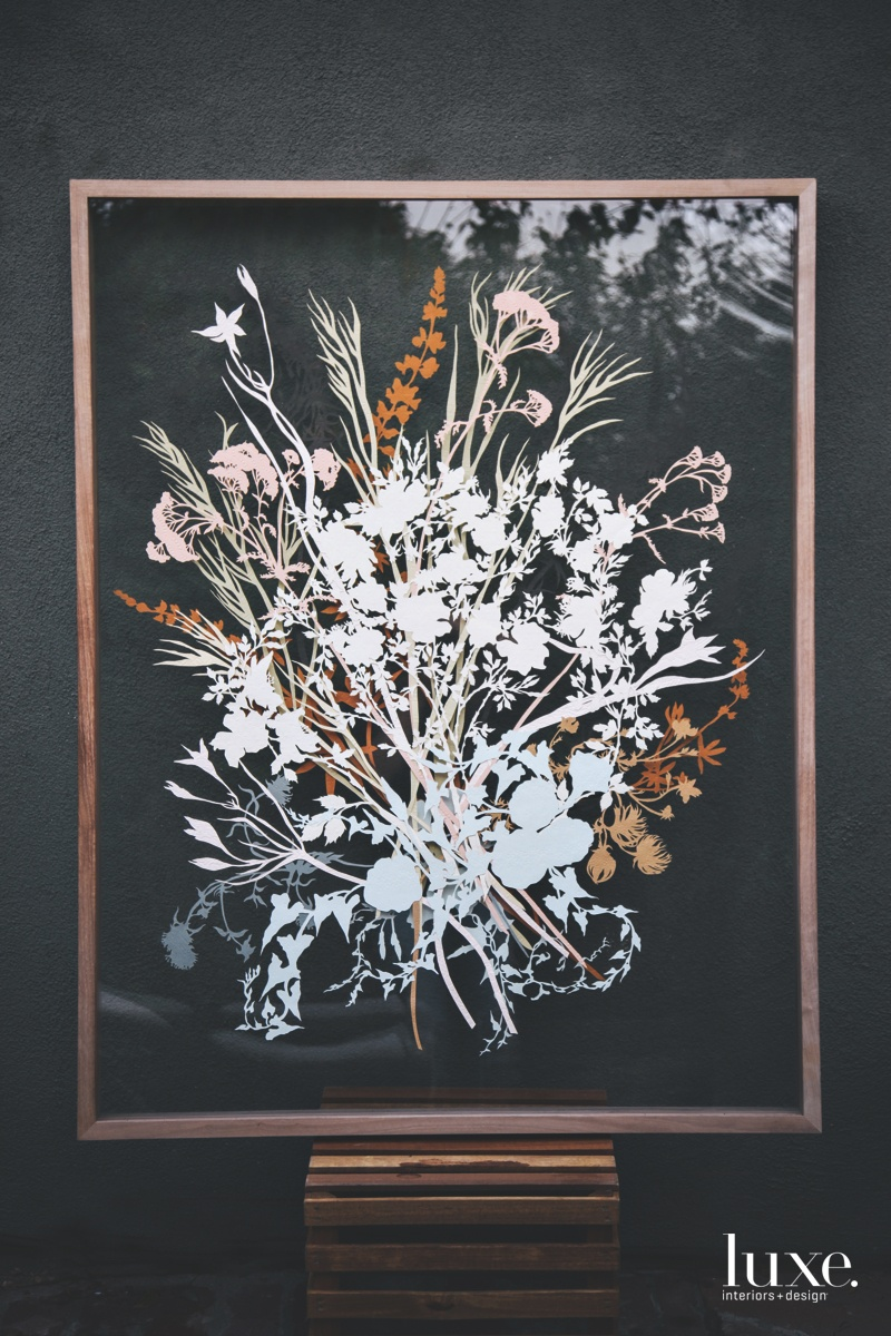 One of Justina's cut-paper works features California native plants including Apache plume, Brodiaea and California wild rose.