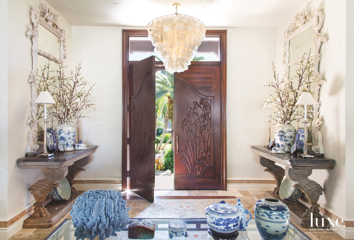 traditional neutral foyer blue accents