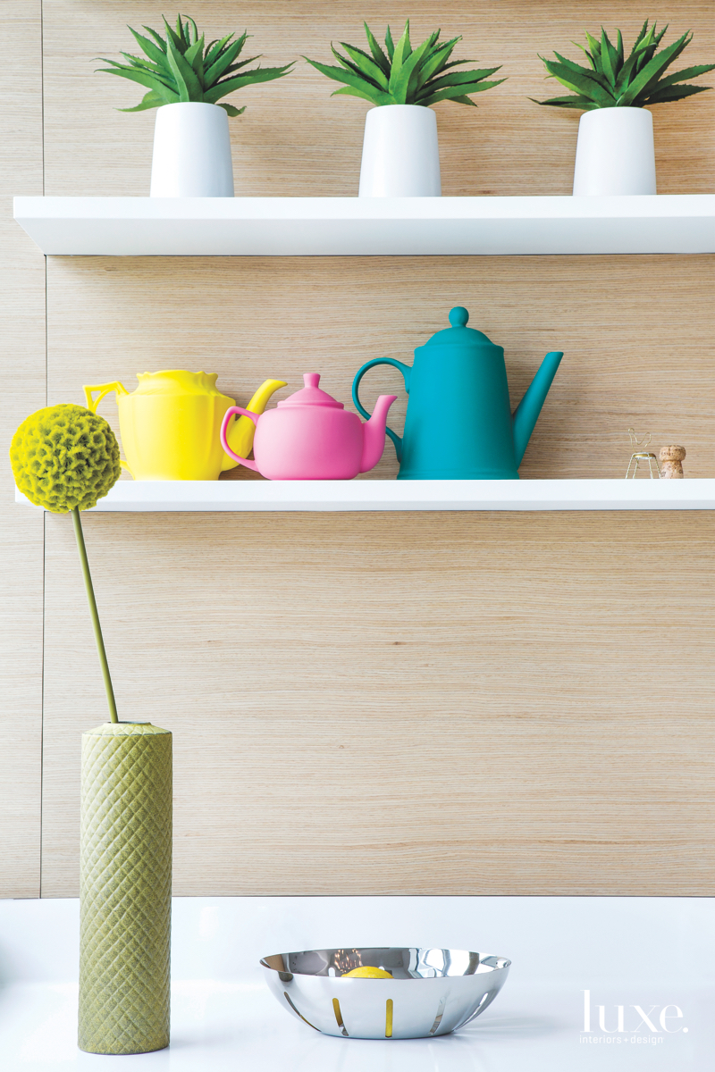 modern colorful teapots and potted...