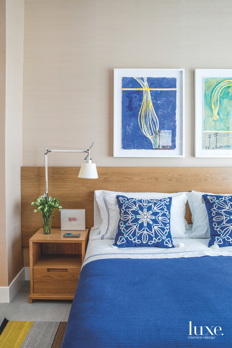 modern bedroom blue accents bed