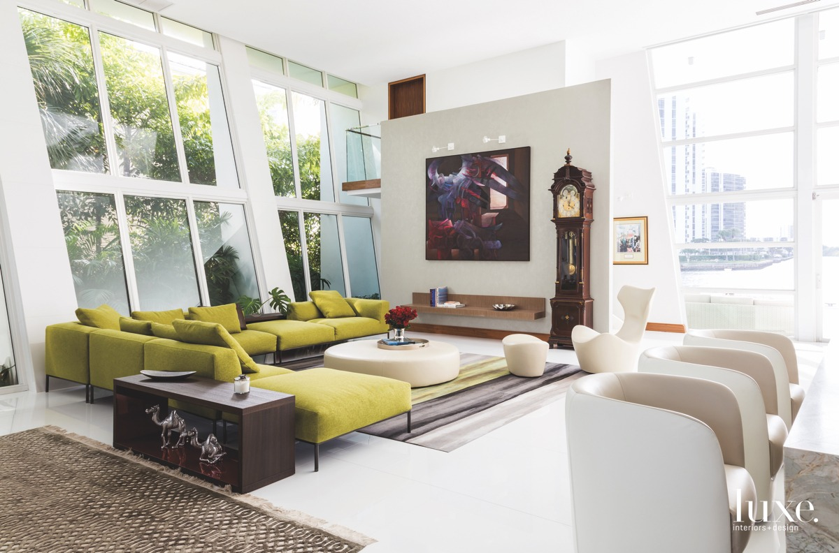 modern living room green couch...