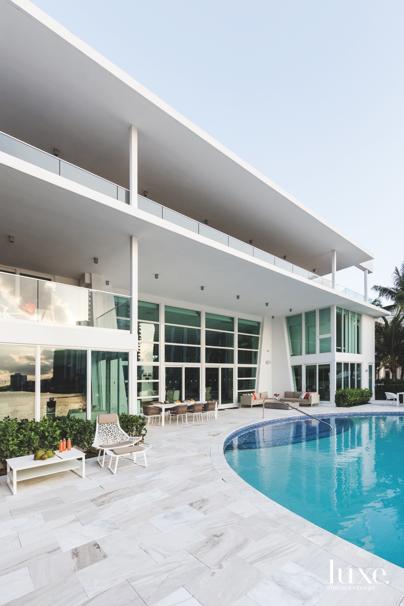 modern exterior pool white sitting...