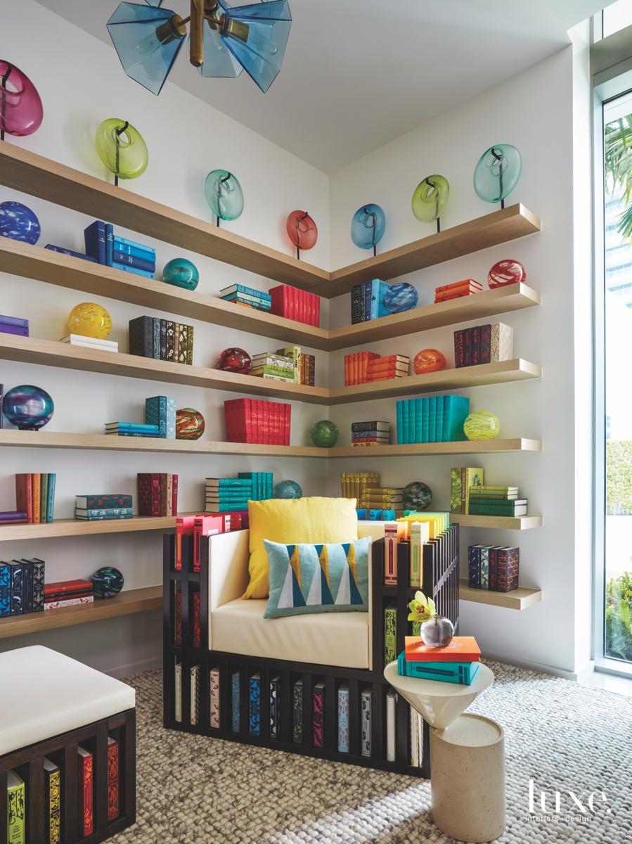 contemporary library multi-colored books glass...