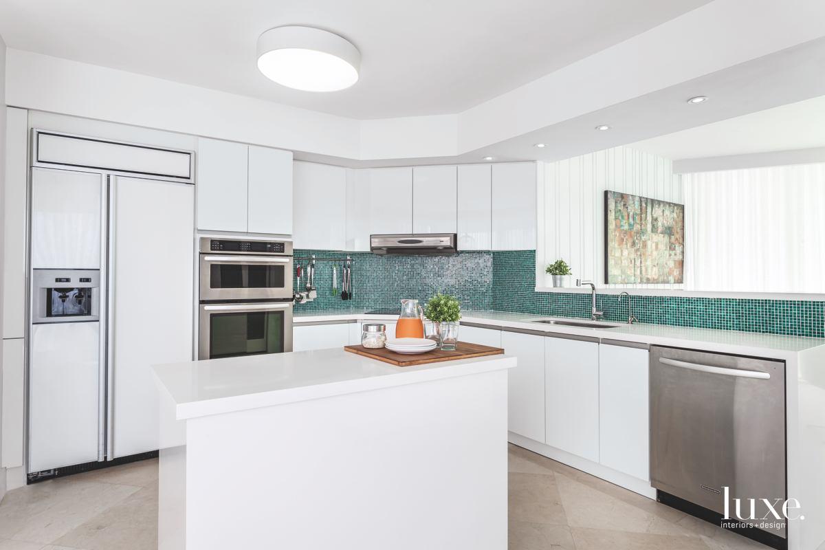 modern white kitchen green mosaic backsplash