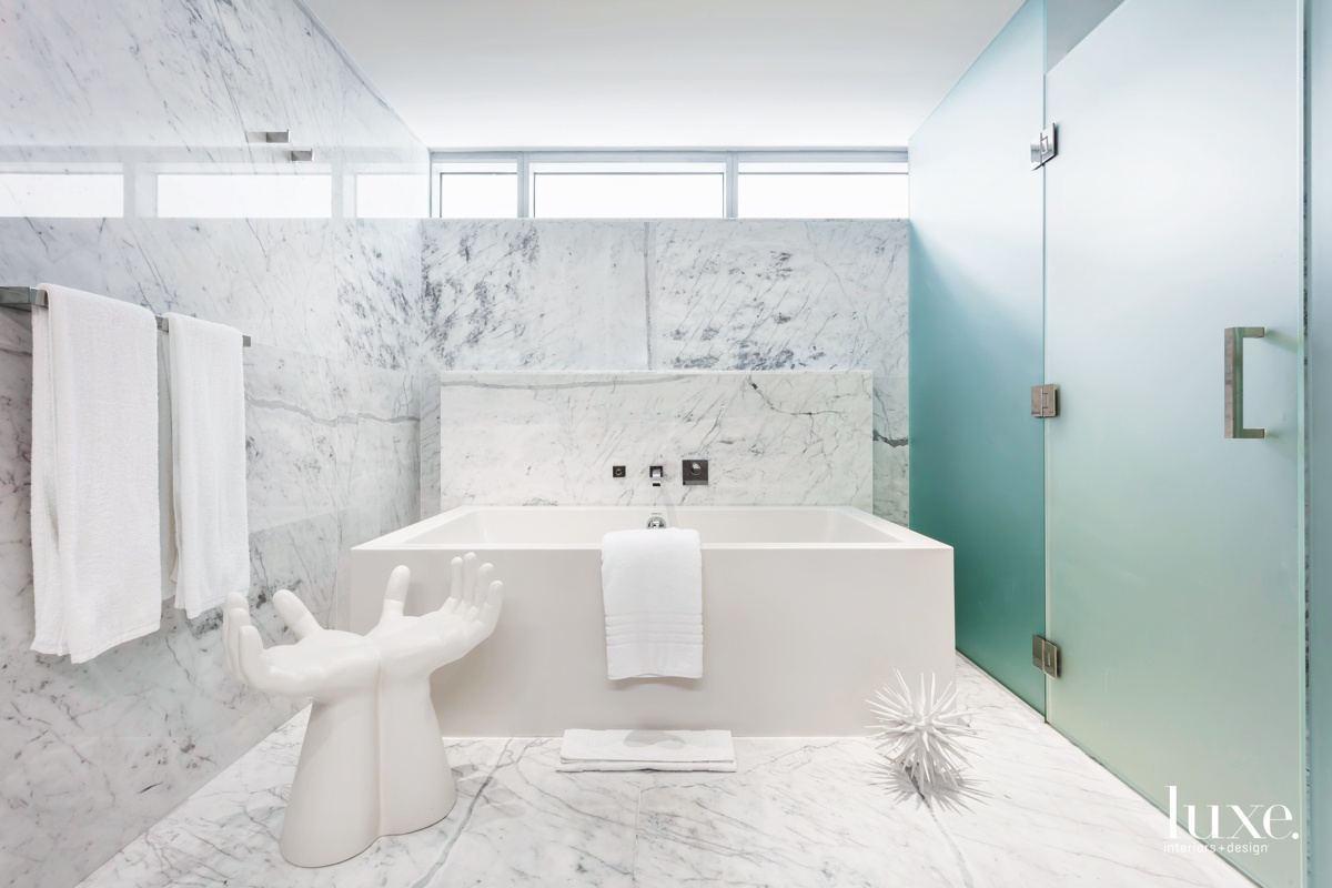 contemporary white marble bathroom open...
