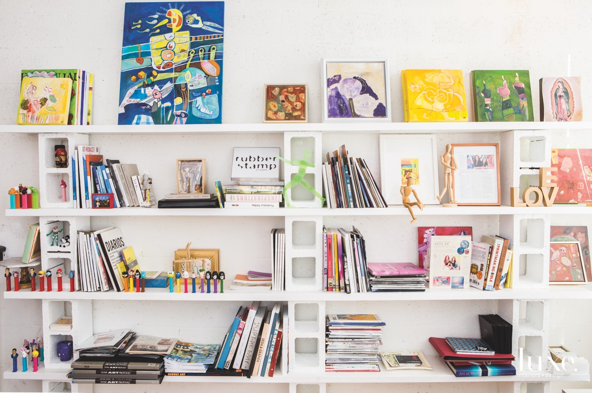"""""""I am not a 'messy' artist,"""" says Brinck, who uses her Pinterest-inspired shelf to help organize books, portfolios and papers."""