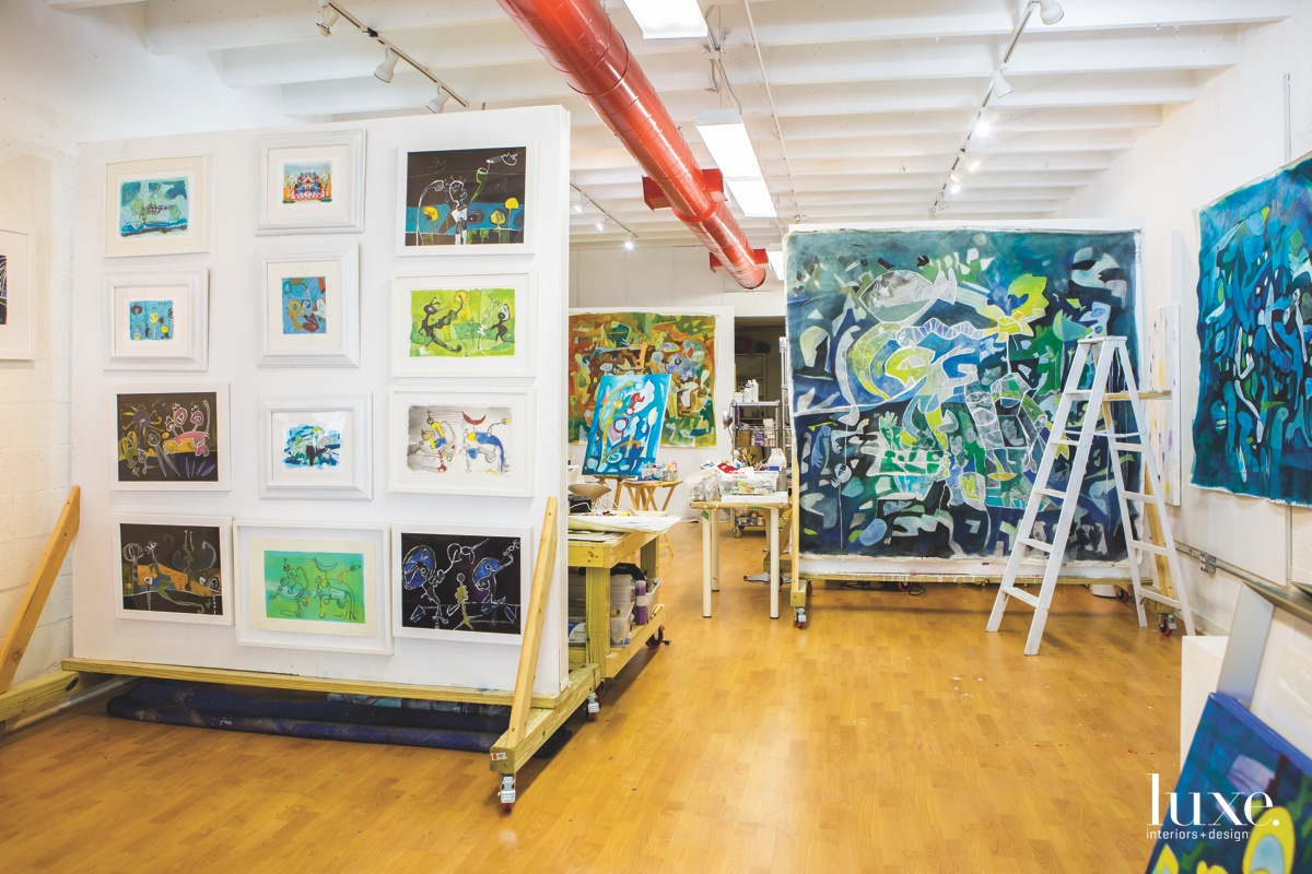 """Conducting her work in the open studio space, the """"walls"""" were outfitted with wheels to easily configure different environments depending on her work flow."""