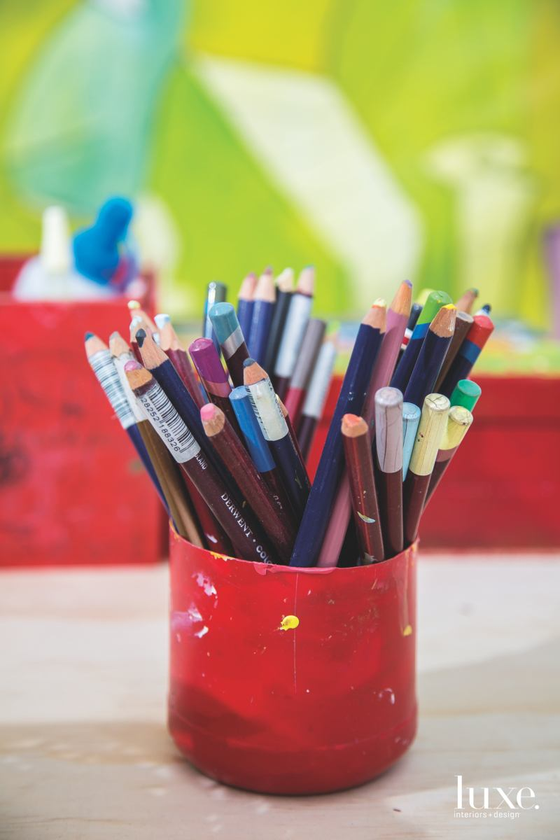 She keeps her pencils and paints neatly separated--a product of her disciplined demeanor.