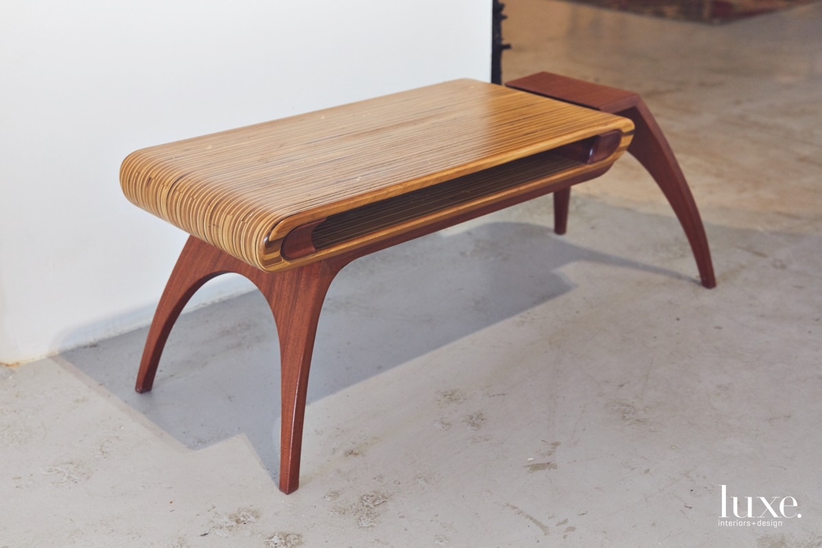 he designer's birch-and-mahogany coffee table--an older work that is representative of his streamlined Scandinavian style.