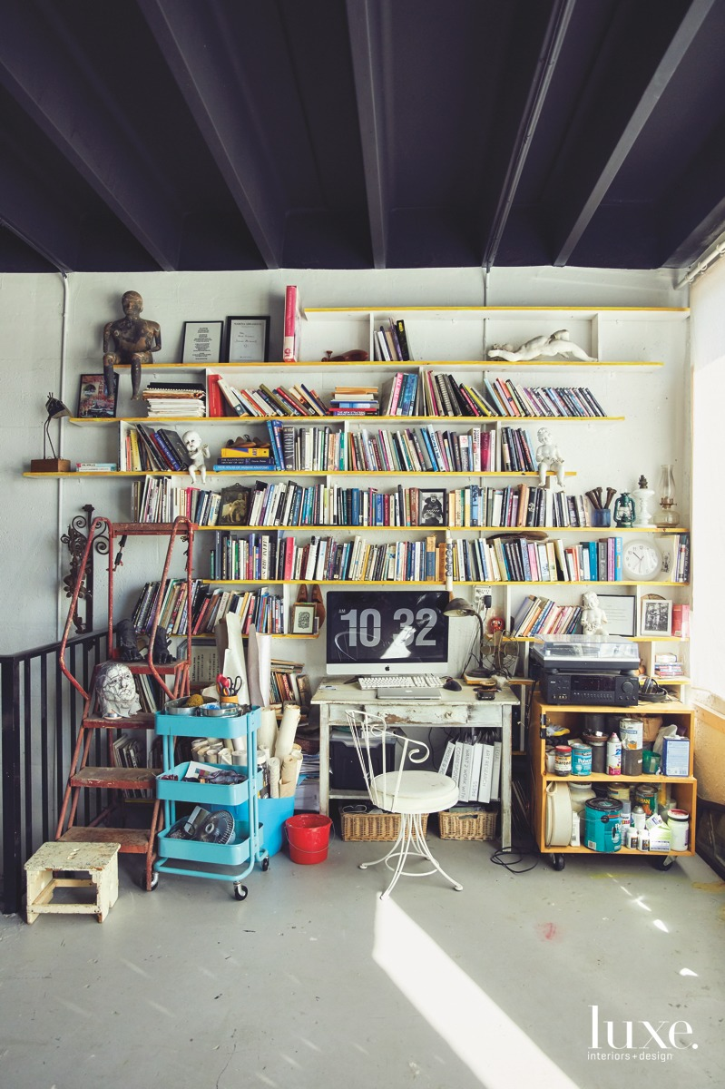 His workstation stores mementos, from favorite philosophy books to quirky statues acquired during his travels.
