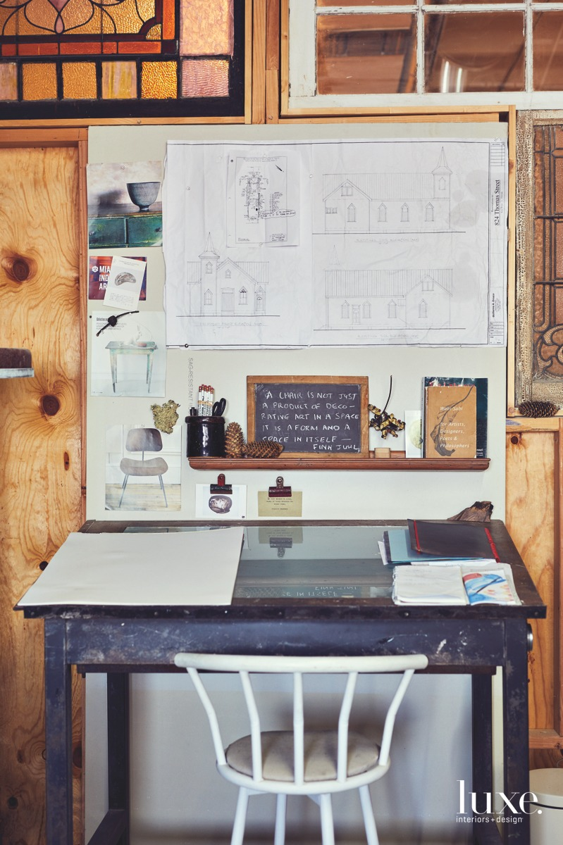 Repenning works through many of his projects at a sketching table, like the renovations of a century-old church in Key West, featured in blueprints on the wall.