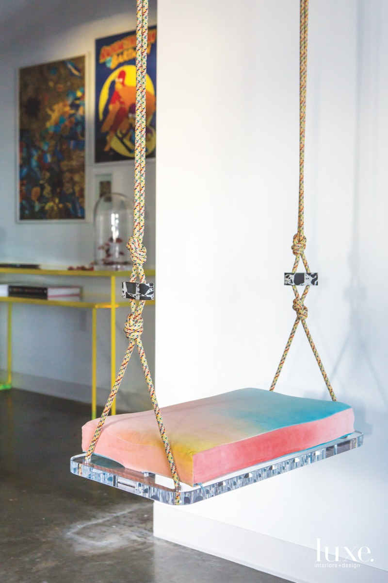Speaking to those fantastical qualities, the artist's Lucite swing is a whimsical nod to nostalgic childhood memories.