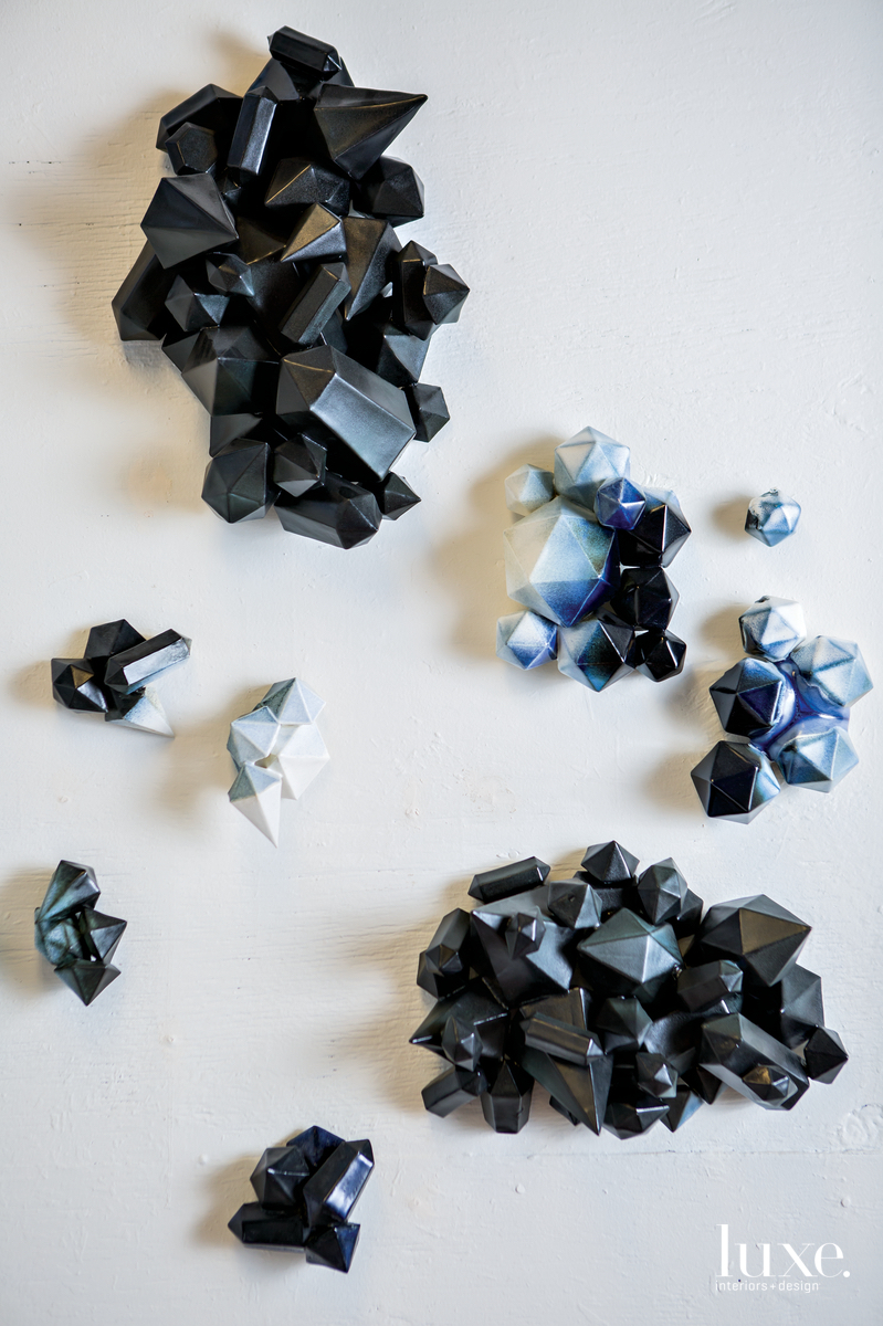 Her wall series, Polygonal Ice Wedges, is cast in black porcelain.