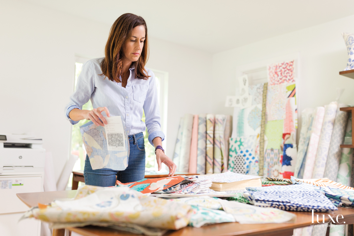 Osterman sorts through fabric swatches in her studio.