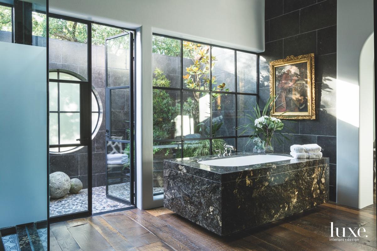 mediterranean bathroom glass windows brass...