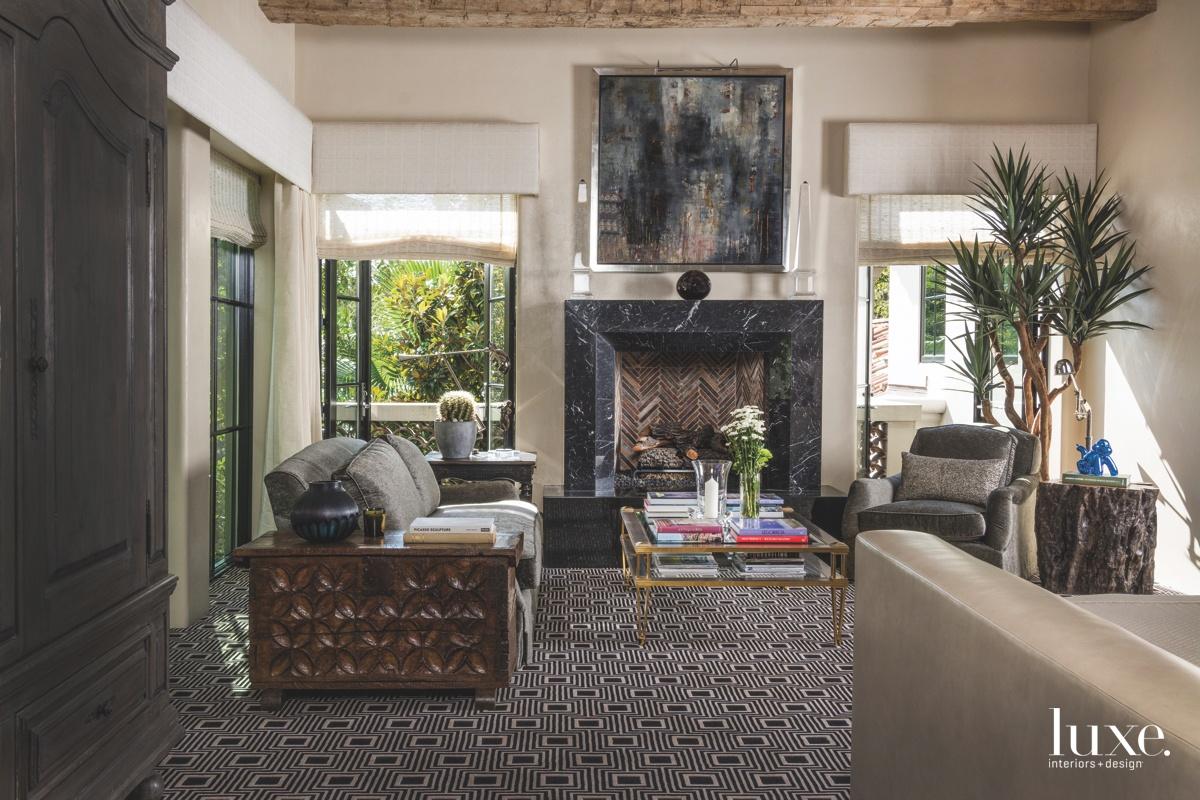 mediterranean master bedroom gray fireplace...
