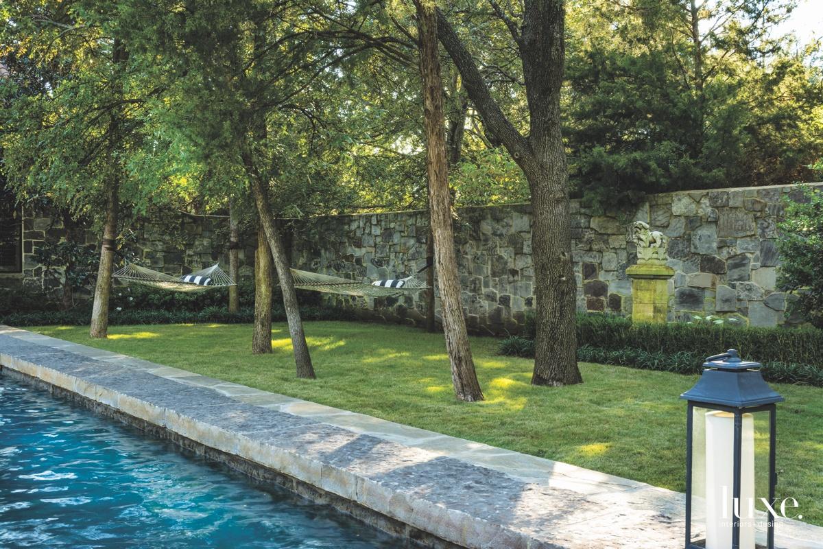 mediterranean exterior pool quartzite deck...