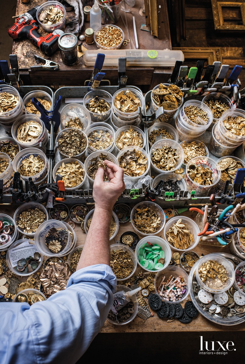 "A table in Mayer's shop overflows with various items he uses to decorate the Museum Bees, including timepieces, gold figurines and gemstones. His working utensils include pliers, nail punches, paint brushes and even his daughter's knitting needles. ""I'm constantly living with a knife in my pocket,"" he says."