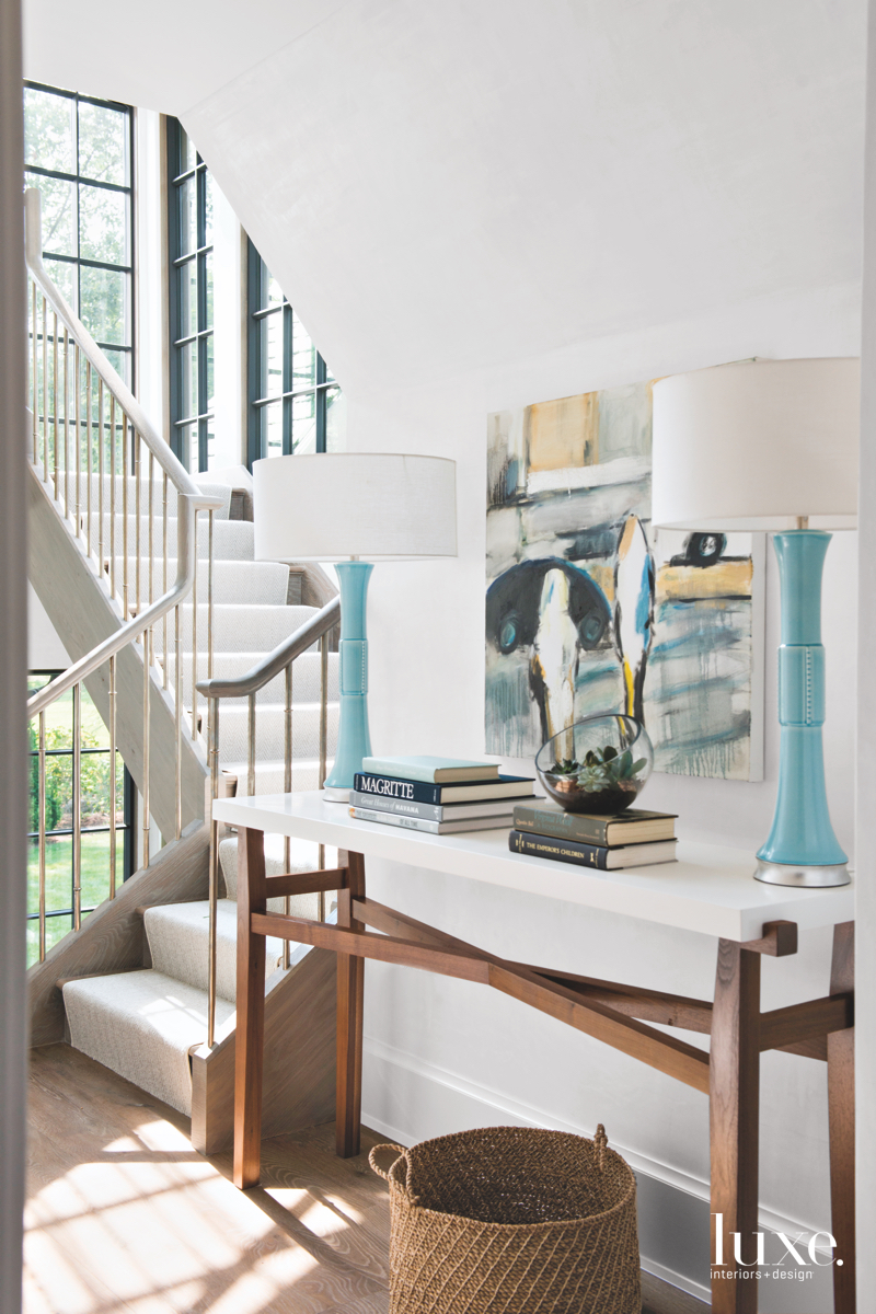 transitional white stairs blue lamps