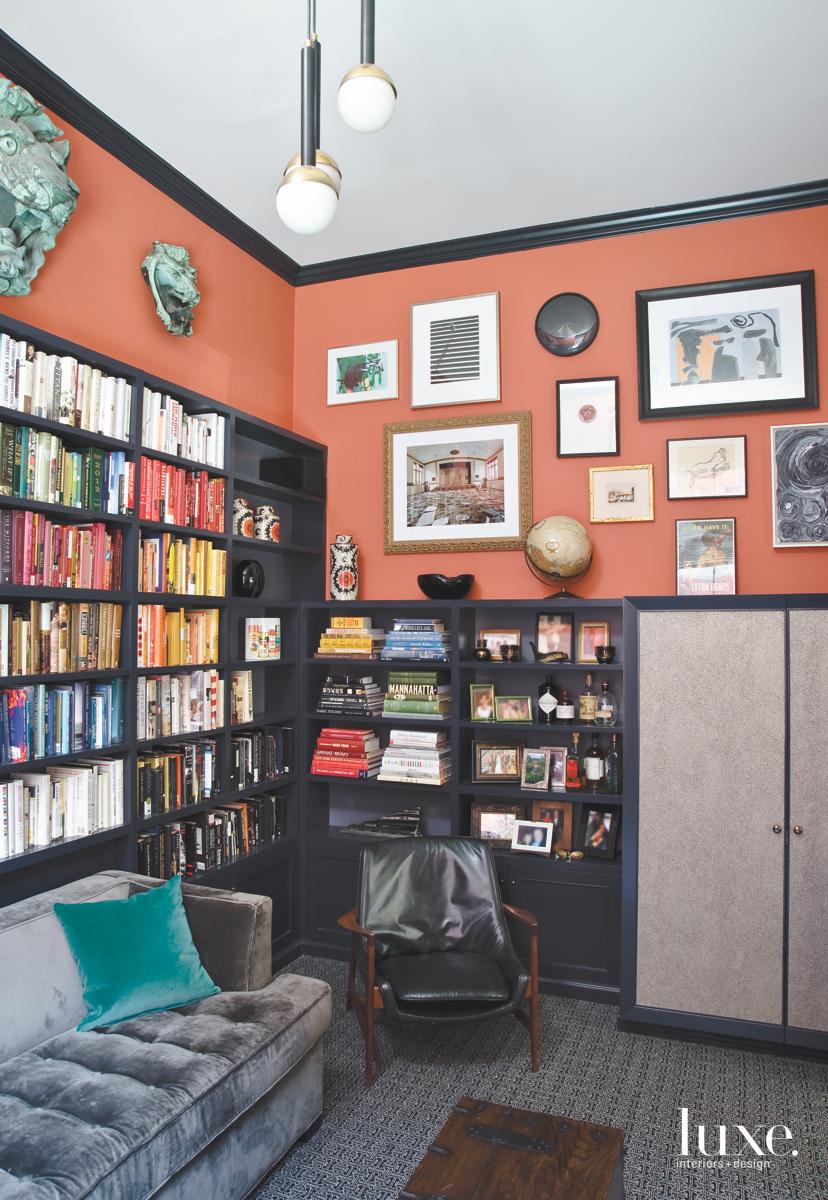 modern study bookshelves orange wall