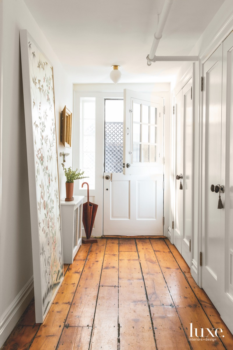 contemporary white door entry hall