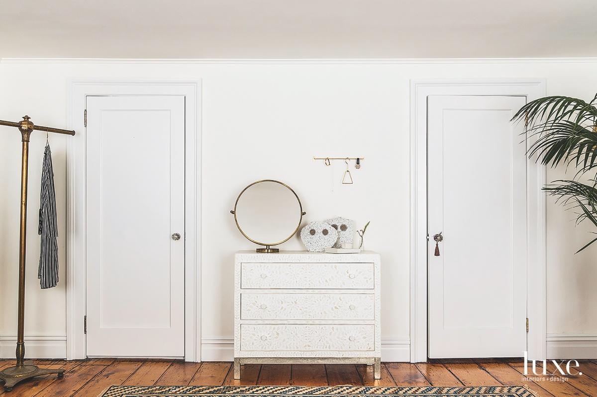 contemporary white bedroom circular mirror