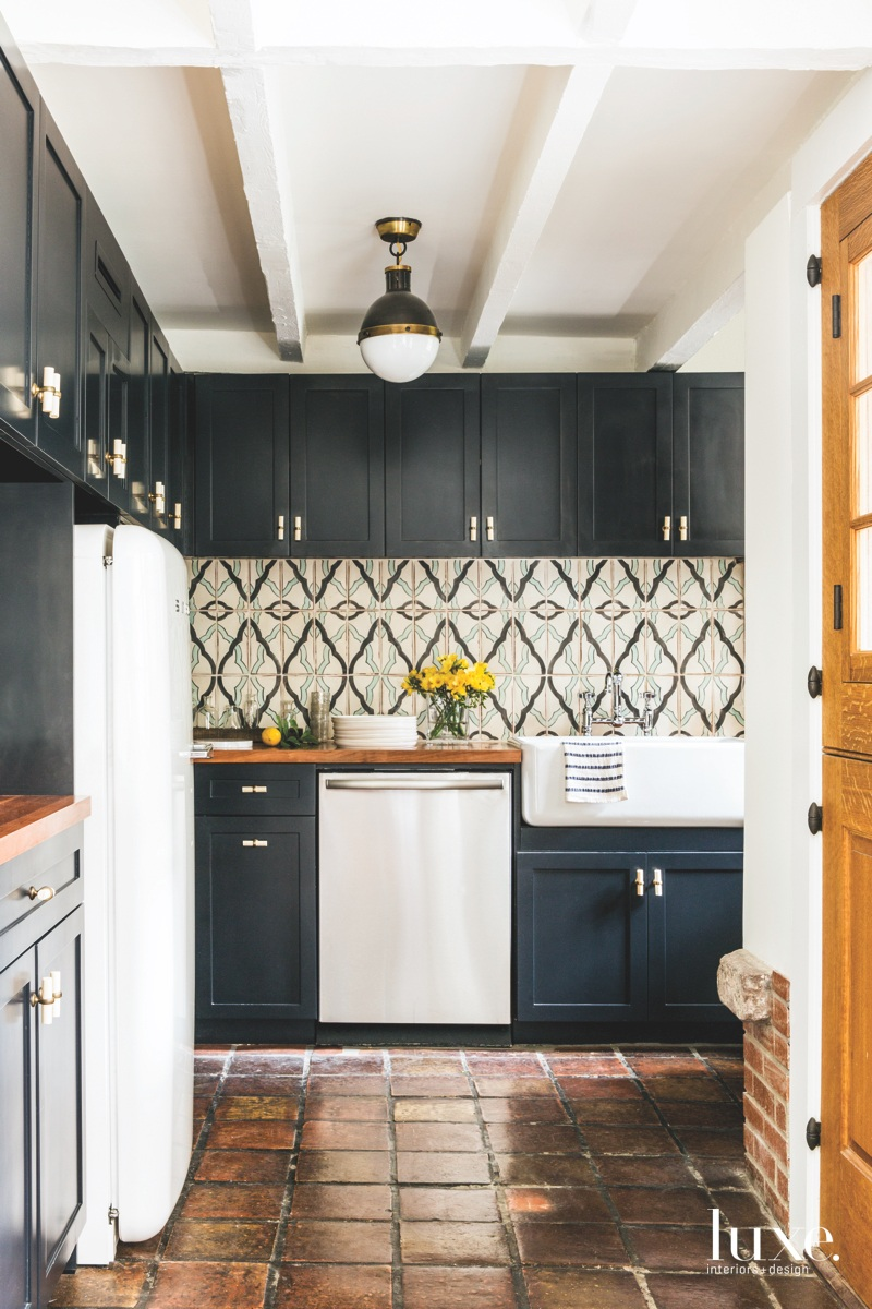 contemporary kitchen black cabinetry patterned...