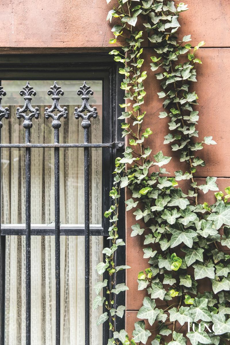 contemporary exterior black barred window