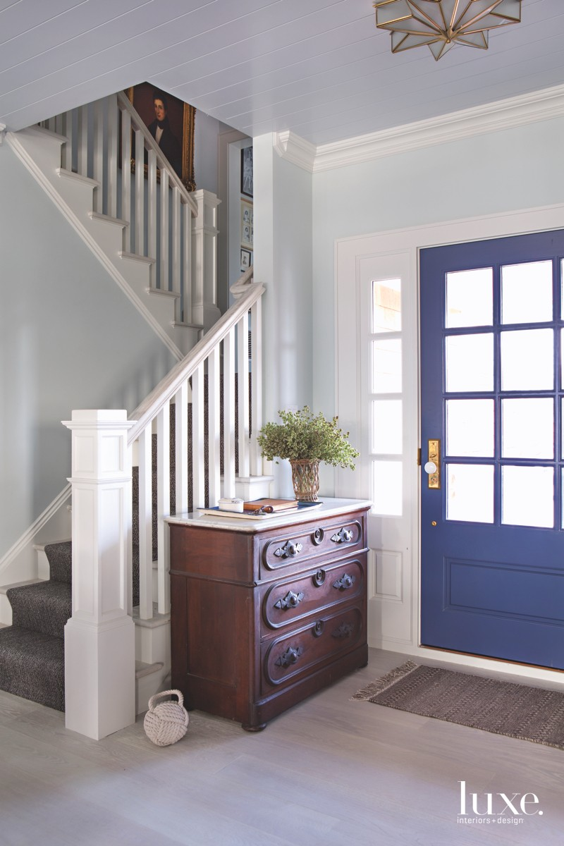 traditional foyer entry blue door...