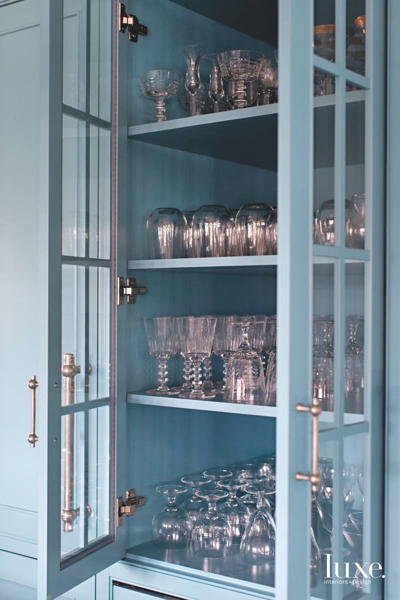 traditional kitchen blue glass-front cabinet
