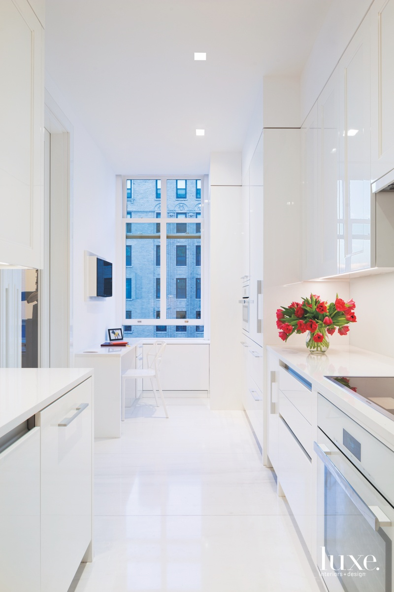contemporary white kitchen white cabinetry...
