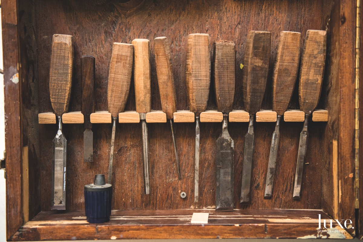 A cabinet of tools can be found in the designer's studio.