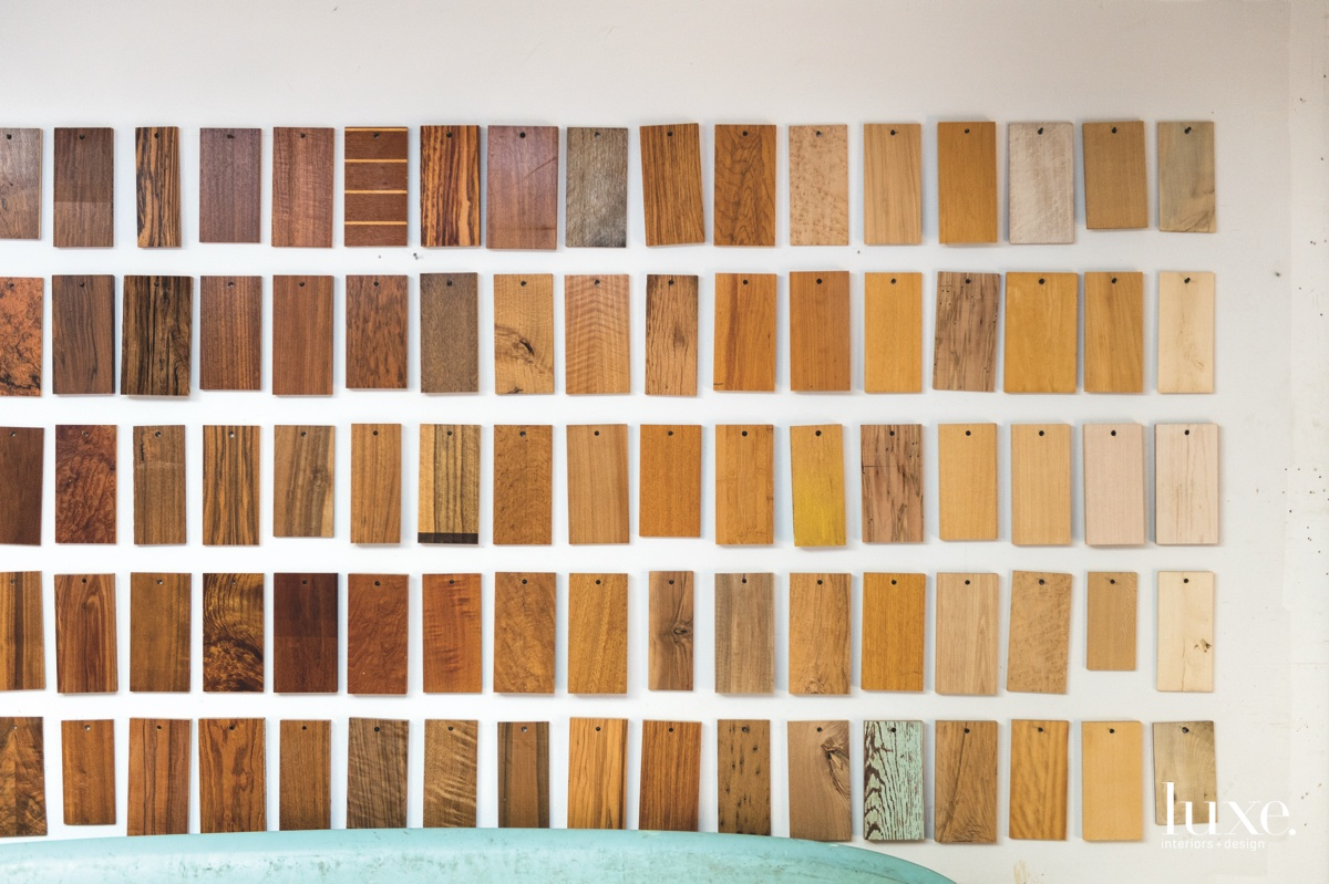 More woods can be seen on a wall of samples in his studio.