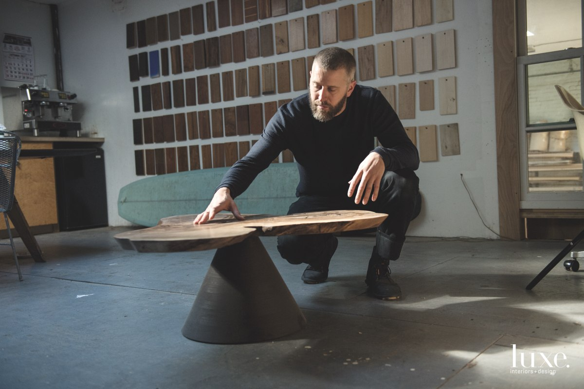 ></noscript></noscript>Brooklyn furniture designer Ben Erickson inspects the top of a custom ebonized-walnut table for an interior design client.