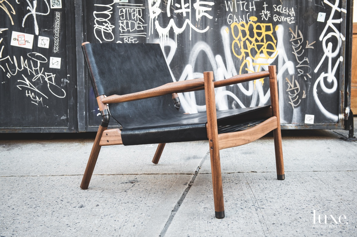 Erickson's EAE lounge chair is available in a variety of materials; here, it's shown in black-matte buffalo hyde, black walnut and raw copper.