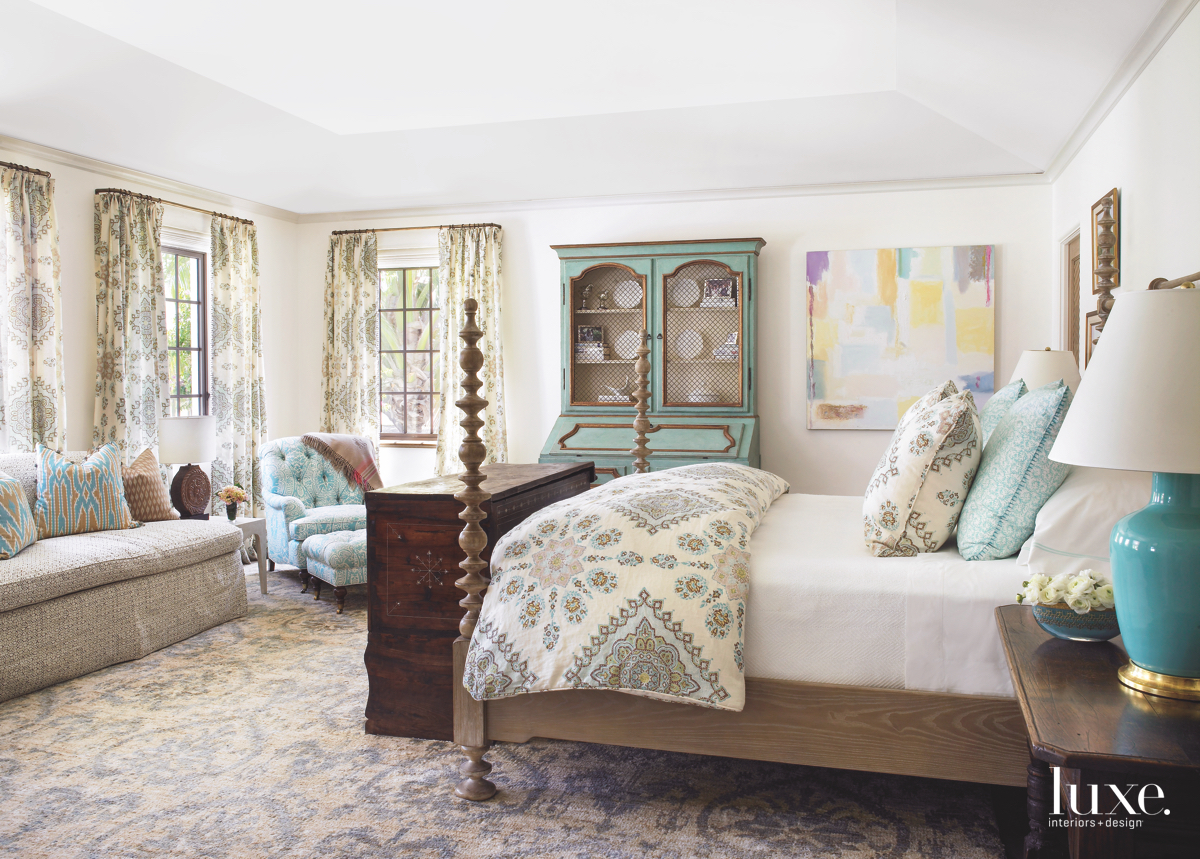 traditional neutral bedroom blue accents