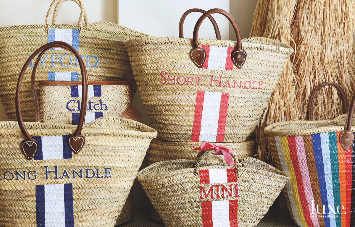 The seagrass totes are handmade and hand- painted, ideal accessories for both the coast and the Palm Beach promenade.