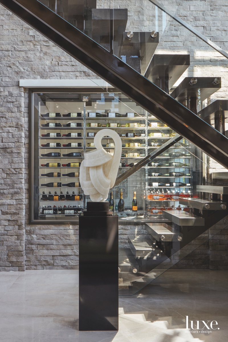 contemporary foyer staircase wine cellar...