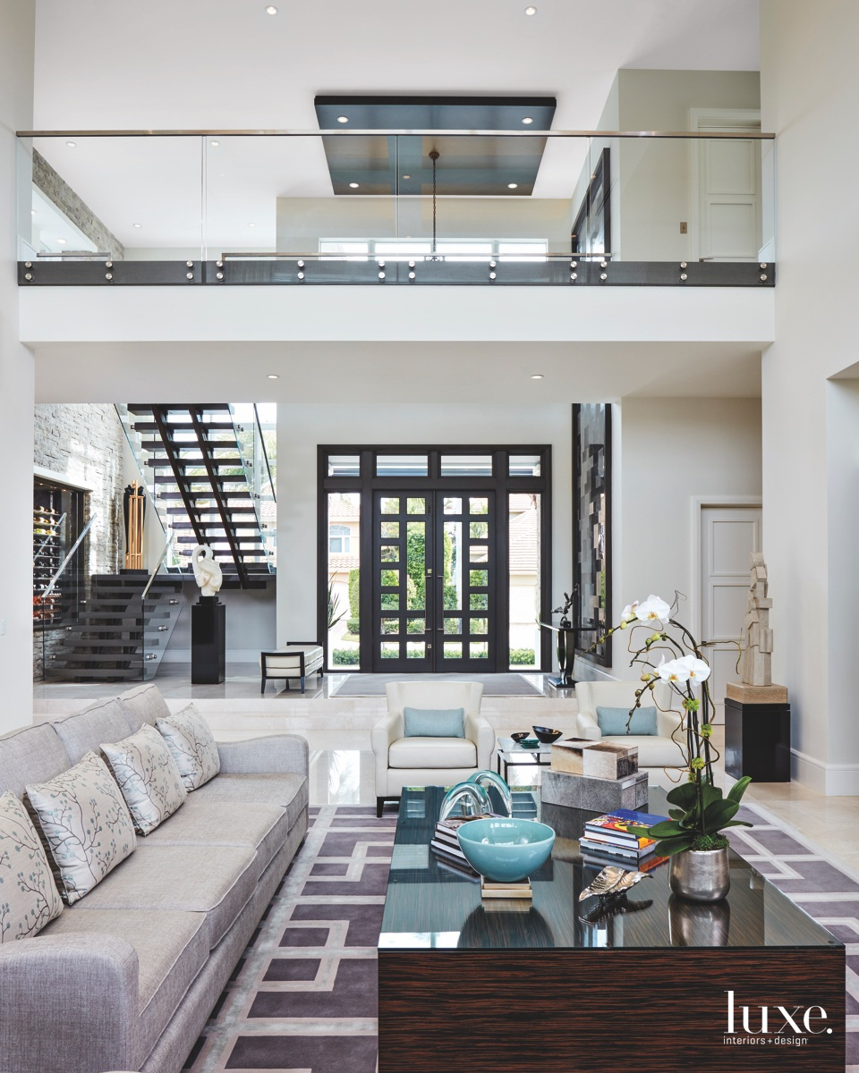 contemporary double-height living room glass...