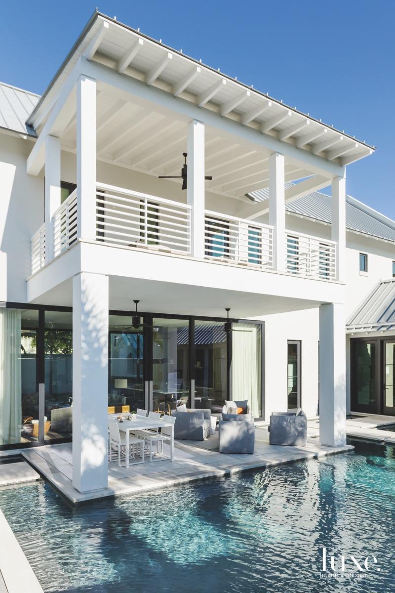 mid-century modern white exterior patio...