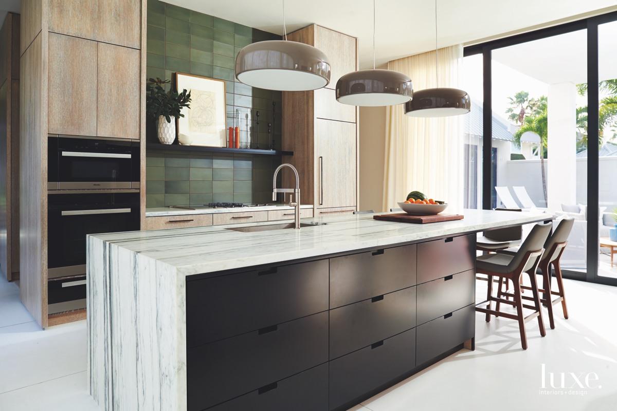mid-century modern kitchen black cabinetry...