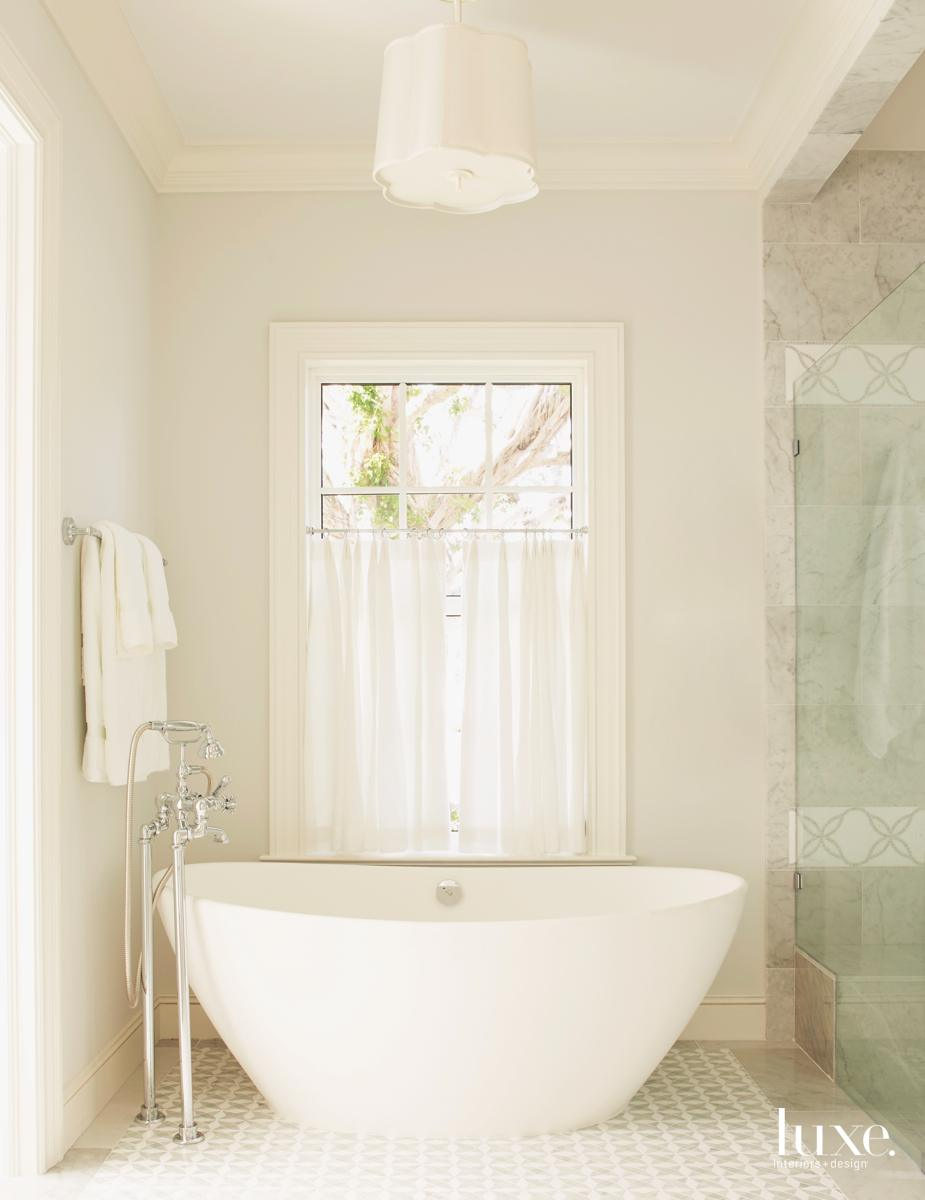 traditional white bathroom freestanding tub
