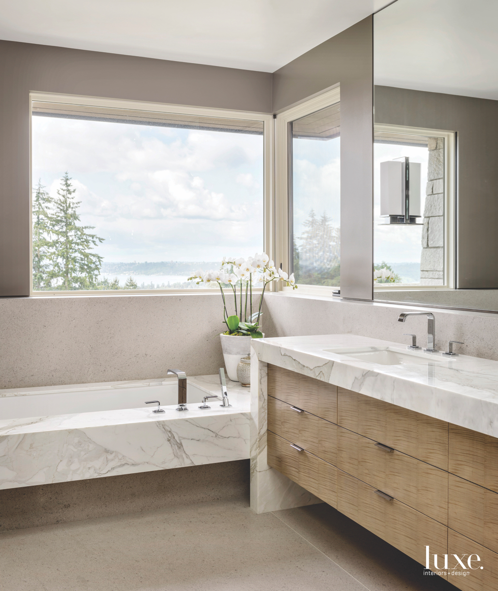modern neutral bathroom marble tub...